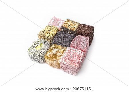 Turkish delight isolated on white background, close-up poster