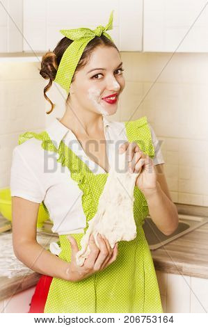 Nice Smiling Woman Cooking Dough