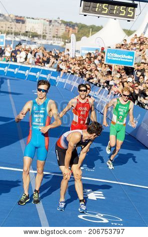 STOCKHOLM - AUG 26 2017: Fighting and running triathletes Gundersen Knabl White and others at the finish in the Men's ITU World Triathlon series event August 26 2017 in Stockholm Sweden
