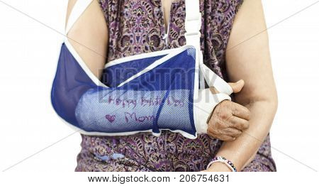 Happy birthday elderly woman with a broken arm on a plaster cast