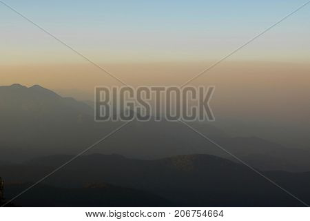 Beautiful twilight layers of silhouettes mountain in Chiang Mai Thailand