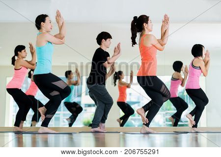yoga group in class room in fitness center Asian girl team stand and action in yoga