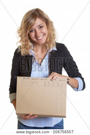 Caucasian secretary with blue blazer and file searching a document