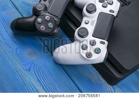 Sankt-Petersburg Russia September 24 2017: Sony PlayStation 4 Slim 1Tb revision and 2 dualshock game controller. Game console with a joystick. Home video game console