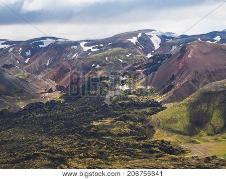 Colored mountains and lava fields in the Landmannalaugar valley Iceland