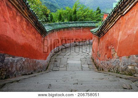 WUDANG SHAN HUBEI CHINA - SEP 09 2017: at the entrance to the Tai chi bua- ancient temple is a center of the Taoist Association of Wudang Mountain. This here is the place for the scene in Journey to the west. And It's especially name.