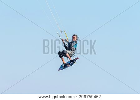 WALVIS BAY NAMIBIA - JULY 2 2017: An unidentified kite surfer airborne at the lagoon at Walvis Bay in the Namib Desert on the Atlantic Coast of Namibia