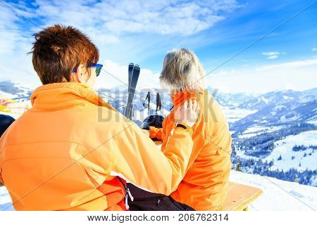 Active senior couple skiing, enjoying a clear winter day.