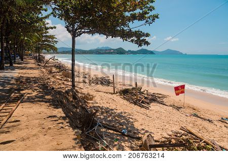 SANYA, CHINA - SEPTEMBER 28, 2017: Consequences after typhoon, on the island of Hainan. Destructions after night hurricane on the coast of the South China Sea.