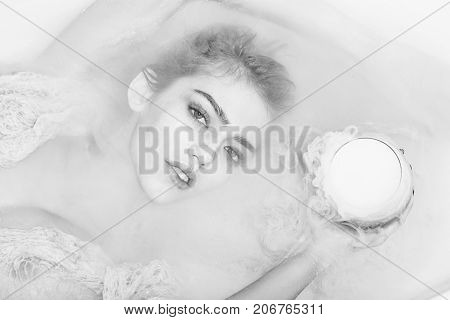 Closeup Of Woman With Glass In Bath