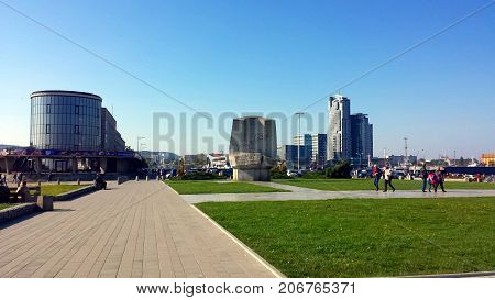 Gdynia, Poland - October 01, 2017: People visit Kosciuszko Square - representation places in Gdynia, on the background of the city of Gdynia, Poland.