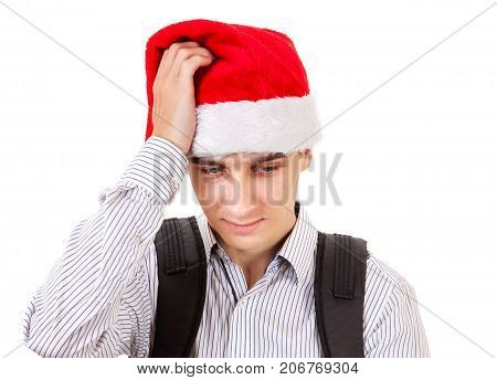 Sad Young Man in Santa Hat Isolated On The White Background
