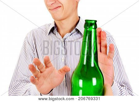 Young Man refuse a Bottle of the Beer on the White Background