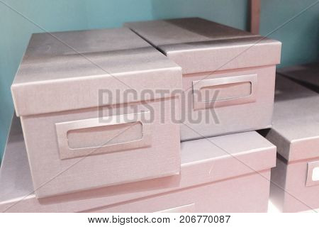 Stack of Office Storage Boxes or Archive Boxes Used for Storing Paper Media and Accessories.