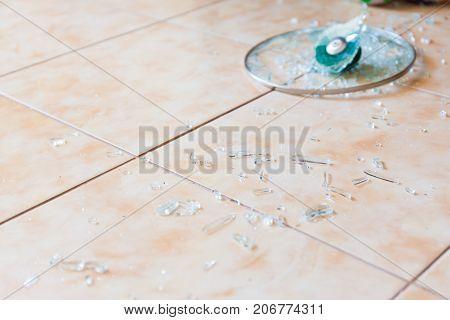Broken Glass Lid On The Floor.