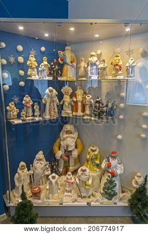 Figurines Of Santa Clauses And Snow Maidens.