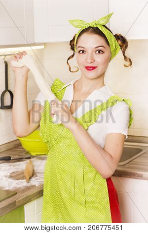 Smiling Woman Housewife Cooking Dough In The Kitchen