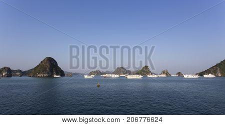 Halong Bay Vietnam - December 28 2016: view of the Halong Bay full of boat cruising