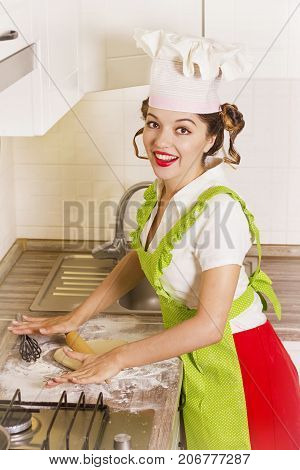 Smiling Young Woman Chef In Chef Hat Cooking Dough With Help Rolling Pin