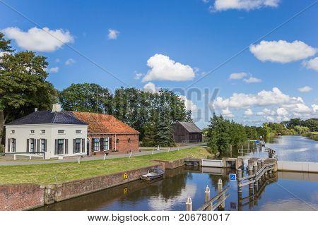 Old house at the Winsumerdiep river in Groningen Netherlands