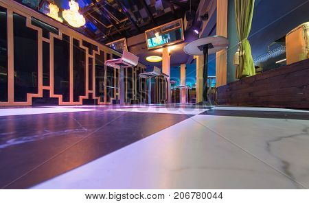 Low Angle View Of Bar Counter In Discotheque Interior