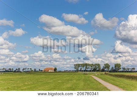 Little farm in a dutch landscape near Groningen Netherlands