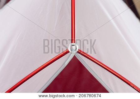 Close up detail of camping tent. Aluminum tent poles. Process of installing tent setting up tent outdoors.
