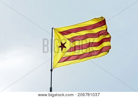 Yellow-red flag with five-pointed star. Red
