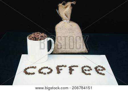 cup of coffee with a sac on a table