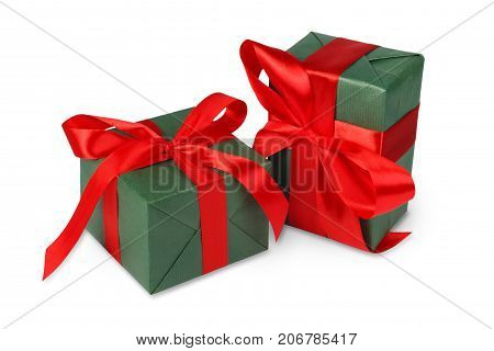 Group of gift boxes wrapped with green paper and red satin ribbon, isolated on white background. Modern presents for any holiday, christmas, valentine or birthday
