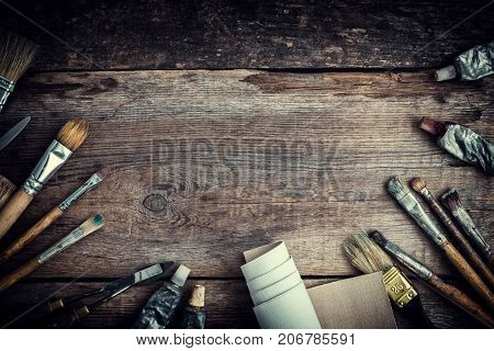 Paint Tubes, Brushes For Painting And Palette Knifes On Old Wooden Background. Top View. Flat Lay. R