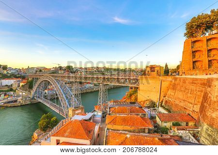 Aerial view of Dom Luis I on Douro River and Monastery of Serra do Pilar at sunset in Vila Nova de Gaia, Porto, Portugal. Picturesque Oporto urban landscape.