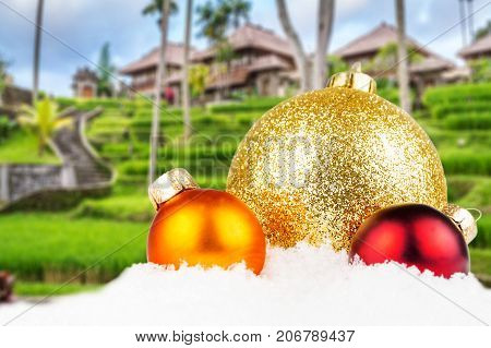 Combination Of Christmas Motivated Front With Blurred Typical Balinese Architecture Background
