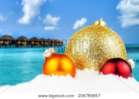 Combination Of Christmas Motivated Front With Blurred Tropical Island Background