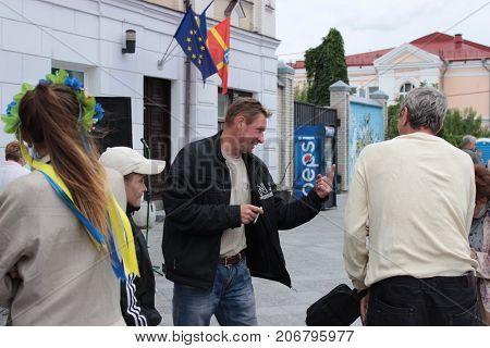 Zhytomyr Ukraine - September 23 2016: man want to explain something on street