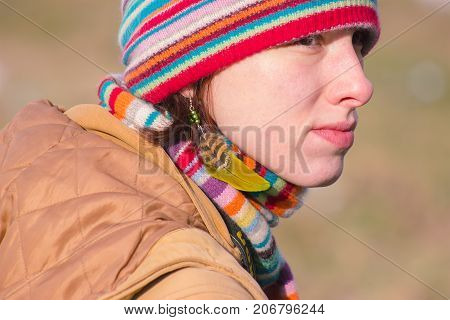 Zhytomyr Ukraine - October 03 2015: attractive young woman in ethnic feather. close up portrait. Beautiful girl shaman. Portrait of a woman with a painted face. Makeup and bright style.