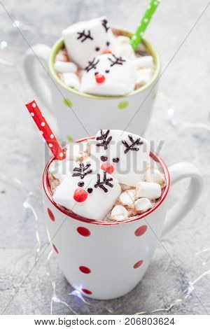 Christmas mugs with hot chocolate with melted marshmallow reindeers
