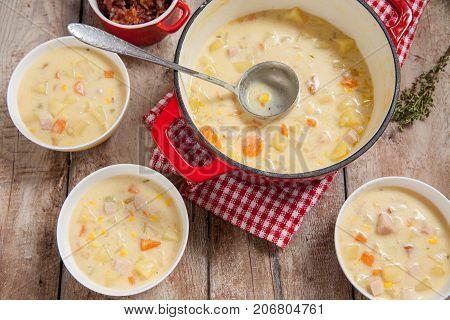 Ham potato and corn chowder in iron pot