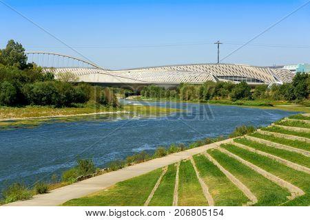 ZARAGOZA, SPAIN - AUGUST 19, 2017: A view of the Ebro River in Zaragoza, Spain, and the Bridge Pavilion and the Tercer Milenio bridge, both built for the international exposition Expo 2008