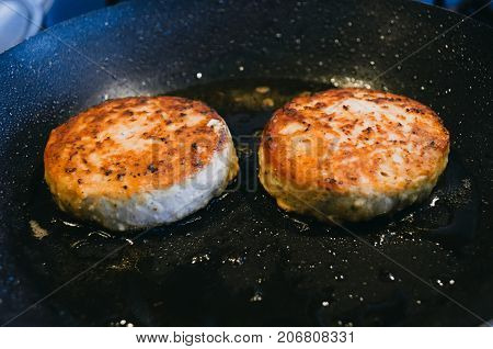Two Round Cutlets From Meat Of Beef Are Fried In A Frying Pan And Oil.