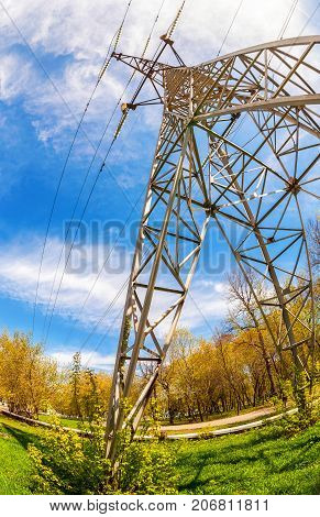 High voltage electric tower against the blue sky. Power transmission line