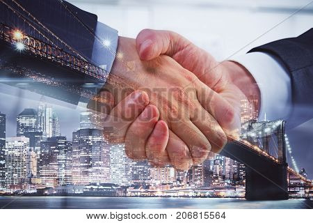 Side view and close up of professional handshake on abstract modern downtown city background. Partnership concept. Double exposure