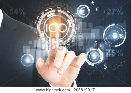 Businessman pressing abstract glowing digital currency button ICO initial coin offering on virtual digital electronic user interface. Finance concept. 3D Rendering