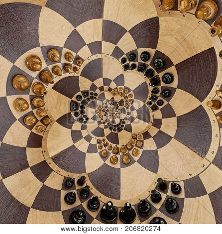 Abstract wooden chess desk white black figures spiral effect flower shape. Chess wooden board abstract spiral fractal Surreal chess board figures spiral background pattern incredible fractal effect Chess game