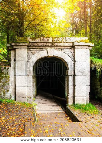 Lower entrance to tunnel of historical Schwarzenberg shipping canal, Sumava Mountains, Czech Republic.