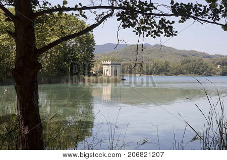 Bañolas Lake And A Tower With Its Reflection