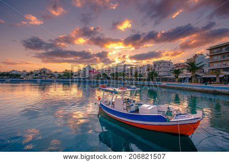 The pictursque port of Sitia, Crete, Greece at sunset. Sitia is a traditional town at the east Crete near the beach of palm trees, Vai.