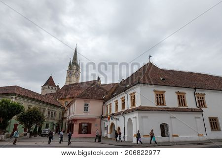 MEDIAS ROMANIA - SEPTEMBER 22 2017: Saint Margaret (Sf. Margareta) church in the afternoon seen from the main square of Medias one of the main cities of Transylvania