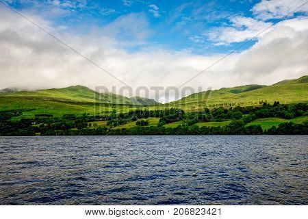 Green Grass Hills Slopes Landscape At Loch Tay In Central Scotland
