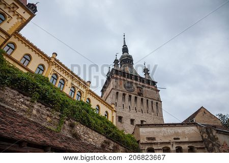 Sighisoara Clock Tower (Turnul cu Ceas) during a cloudy fall afternoon. It is the main entrance of Sighisoara castle in Romania birthplace of Vlad Tepes aka Dracula